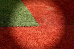 Red and green grass. A green grass wedge on a field of red grass in a circle of light Stock Images