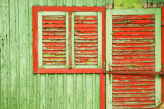 Red green color contrast. On a shabby wooden wall Stock Images