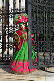 Red green costumed masked woman portrait Royalty Free Stock Photography