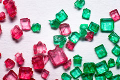 Red and green crystal lollies. Red and green gem lollies close up Stock Images