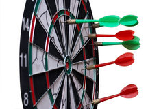 Red and green dart arrow hit the Board. Stock Photography