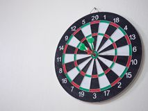 Red and green dart arrow hitting on center target . Stock Photography