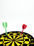 Red and green dart on target Stock Image