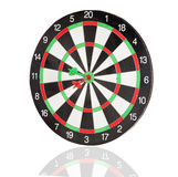 Red and green darts punctured in the center. Of the target isolated on white background stock photos