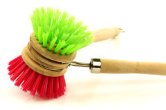 A red and green dish washing brush Stock Photos
