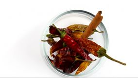 Red and green dried chili peppers stock video footage