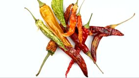Red and green dried chili peppers stock footage