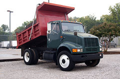 Red and Green Dump Truck Stock Photo