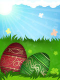 Red and green Easter eggs in grass Royalty Free Stock Photography