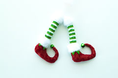Red and green elf boots isolated on white. Red and green toy plush elf boots isolated on white Stock Images