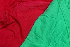 Red green fabric texture from a piece of crumpled matter stock image