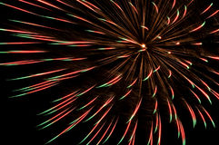 Red and green firework. Big red and green firework on black background stock photography