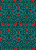 Red and green floral pattern. Pattern with ornamental flowers. Red and green filigree ornament. Colorful template for wallpaper, textile, shawl, carpet and any royalty free illustration