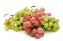 Red and green fresh grapes isolated. Over white Royalty Free Stock Photo