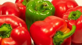 Red and green fresh sweet peppers close up Stock Photos