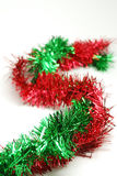 Red and green garland - S pattern. Arrangement of green and red garland braided is an S pattern stock images
