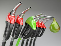 Red and green gas pump nozzle with drop oil. Royalty Free Stock Photo