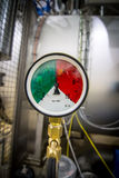 Red-green gauge. Pipeline gauge with green and red zones stock photo