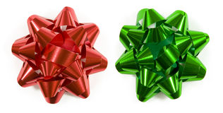 Red and green gift bows. Red and green christmas gift bows isolated on white (top down shot Royalty Free Stock Photo