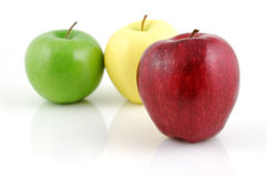 Red, green and golden apples Royalty Free Stock Photo