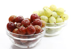 Red and green gooseberries in bowls Royalty Free Stock Photography