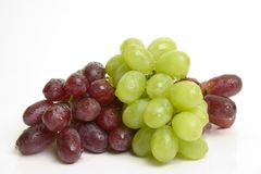 Red and green grapes. Isolated red and green grapes Stock Image