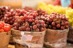 Red and green grapes in baskets Stock Photos