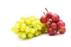 Red and green grapes isolated Royalty Free Stock Photos