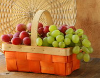 Red and green grapes in  basket Royalty Free Stock Photos