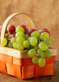 Red and green grapes in  basket Royalty Free Stock Images