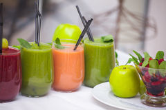 Red and green healthy smoothies with fresh ingredients on table. Stock Photography