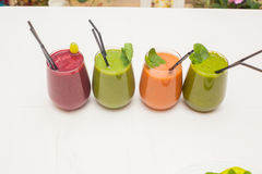 Red and green healthy smoothies on table. Stock Image