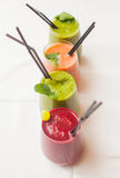 Red and green healthy smoothies on table. Royalty Free Stock Photo
