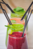 Red and green healthy smoothies on table. Stock Images