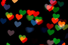Red and green heart bokeh on dark background Royalty Free Stock Photography