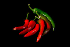 Red and green hot chili peppers Stock Photos