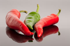 Red and green hot chili peppers background. Red and green hot chili peppers  background with reflection Royalty Free Stock Images