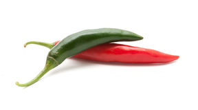 Red and green hot chili peppers isolated Royalty Free Stock Images