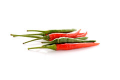 Red and green hot chili peppers with stem on white Royalty Free Stock Photo