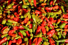 Red and Green Hot Peppers. Close-up of red and green hot peppers displayed at mexican market Stock Images