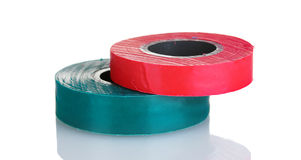 Red and green insulating tapes . Stock Photo