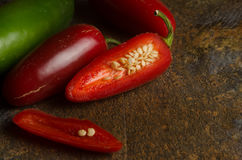 Red and green jalapenos Stock Photos