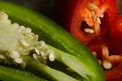 Red and green jalapenos Stock Images