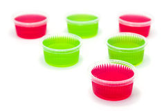 Red and Green jelly in cup on white background. stock images