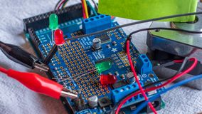 Red and green LED lights being shown in use as part of a microcontroller build royalty free stock image