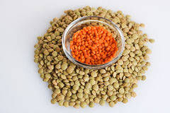 Red and green lentils. On off-white background Royalty Free Stock Image