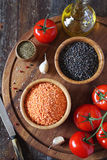 Red and green lentils, tomatoes and olive oil Stock Images