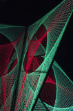Red and green lights created 3D formation in black Stock Photos