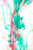 Red and green liquid in water Royalty Free Stock Photo