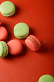 Red and green macaroons on background Stock Images